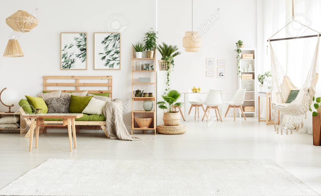 Plant On Pouf And Leaves Posters In Bright Open Space Interior ...