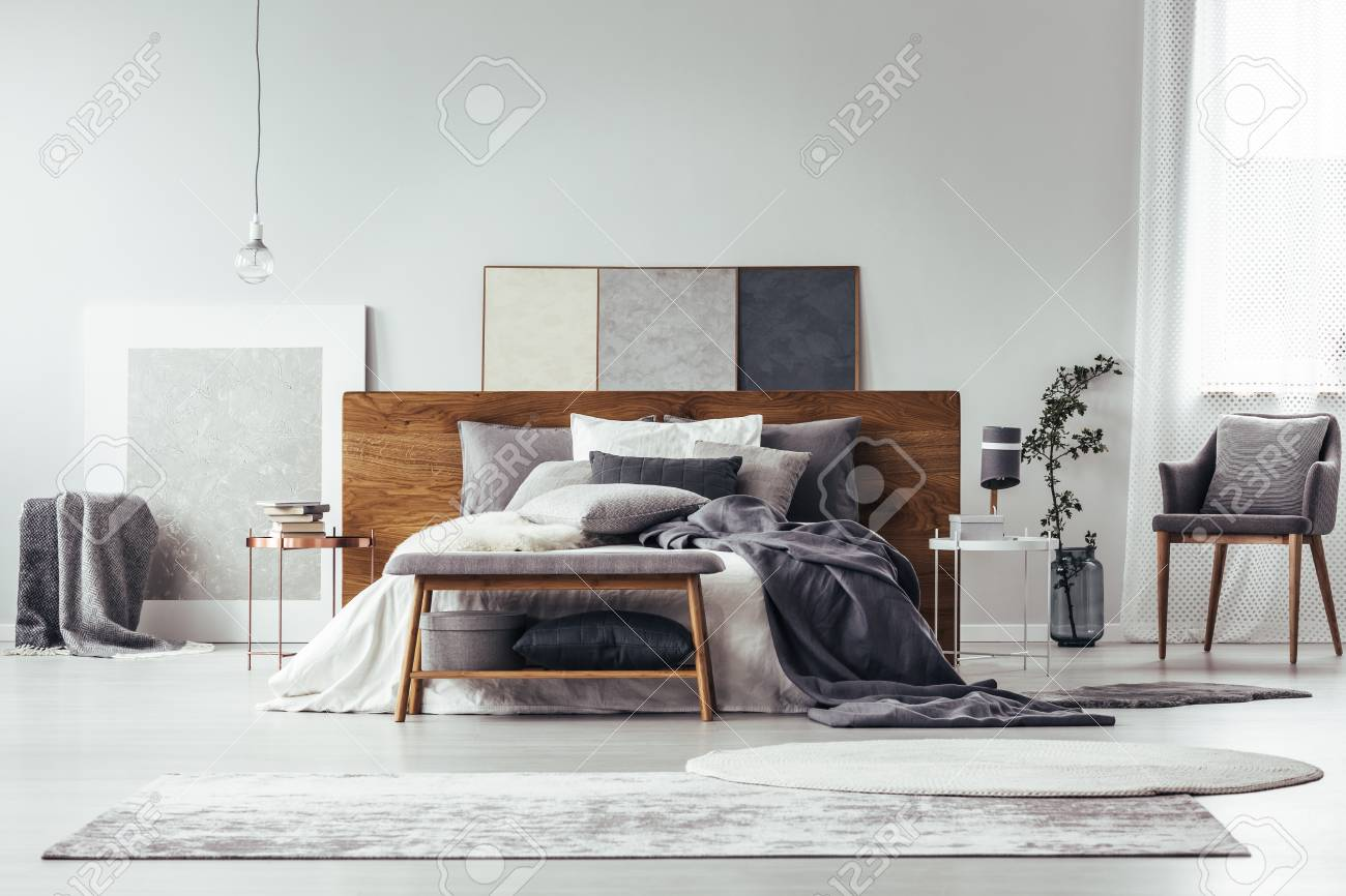 Simple Painting On Wooden Bedhead Of Bed With Pillows In Grey Stock Photo Picture And Royalty Free Image Image 93408204