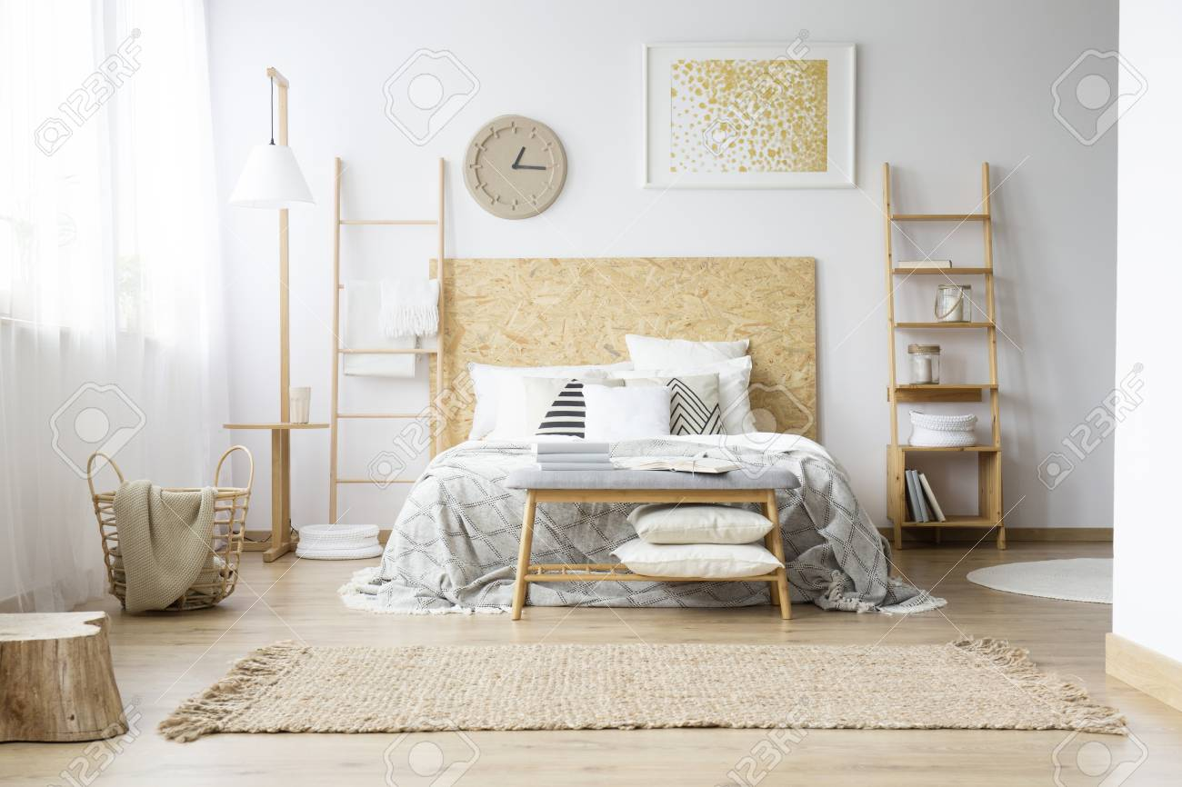 Gold Painting And Handmade Clock In Bohemian Bedroom With King Size Stock Photo Picture And Royalty Free Image Image 93199784