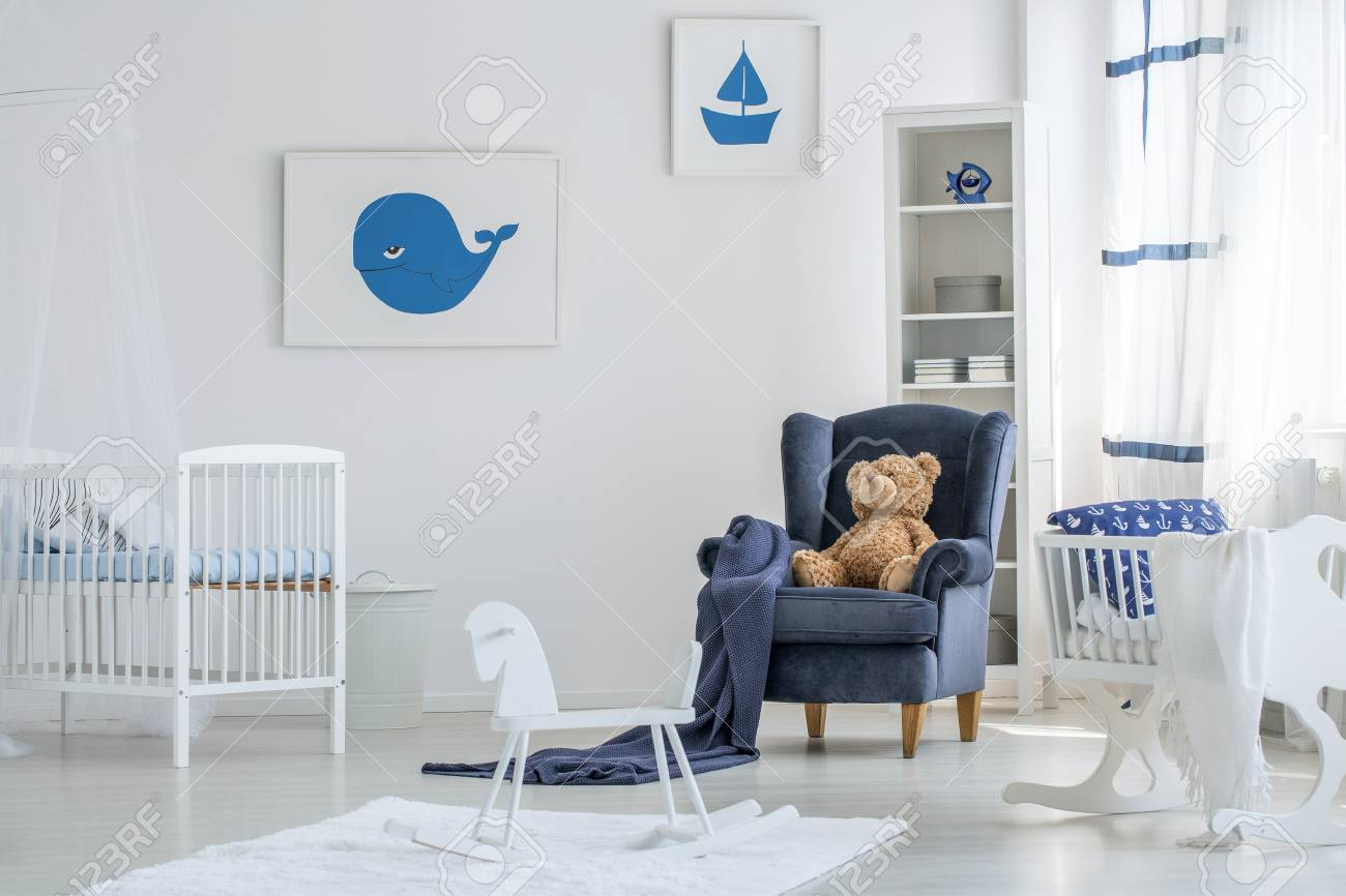 Picture of: White Baby Room Interior With A Rocking Horse On White Rug And Stock Photo Picture And Royalty Free Image Image 93433581