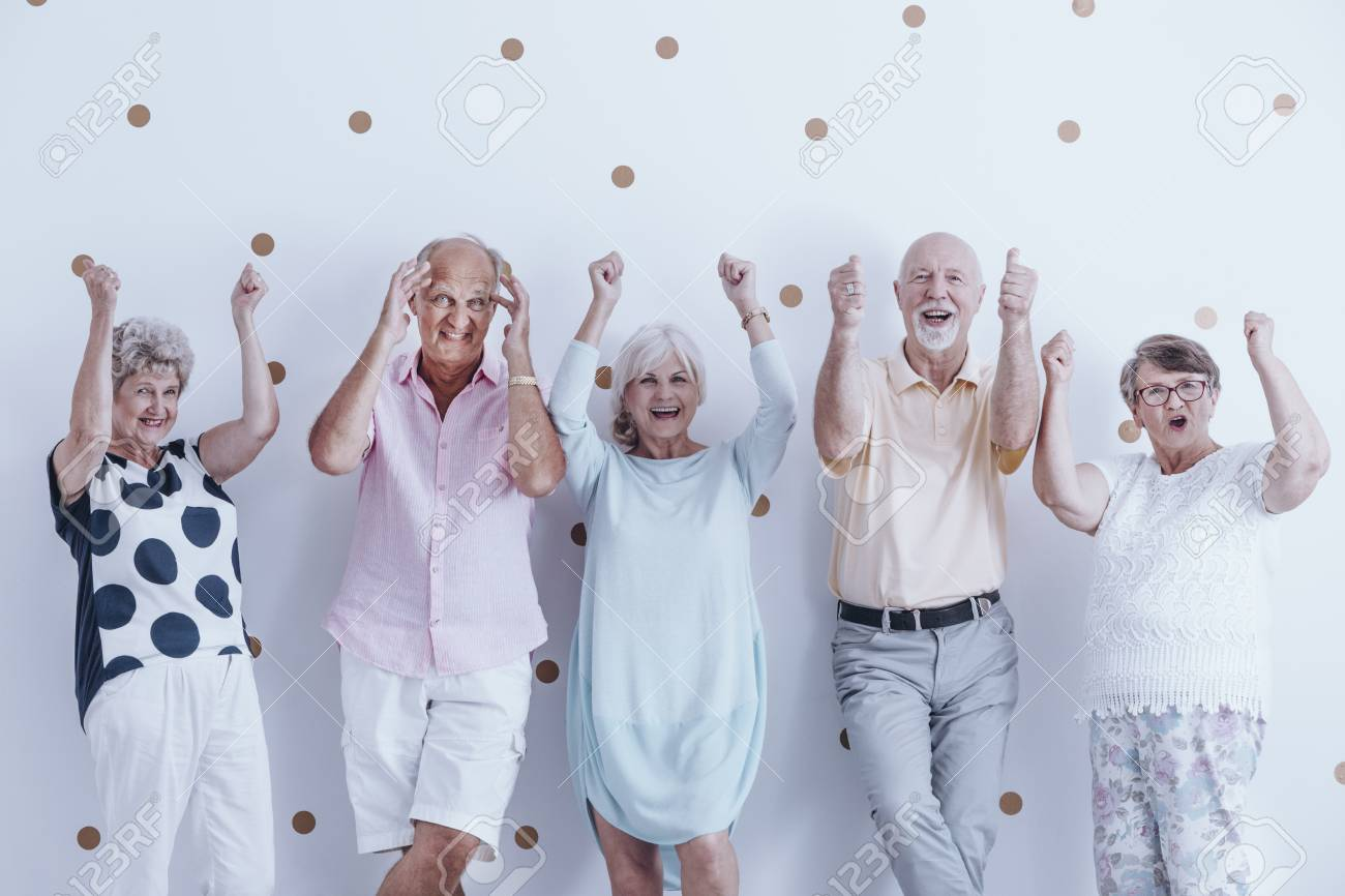 Group Of Enthusiastic Seniors Keeping Their Hands Raised Against Stock Photo Picture And Royalty Free Image Image 93199826