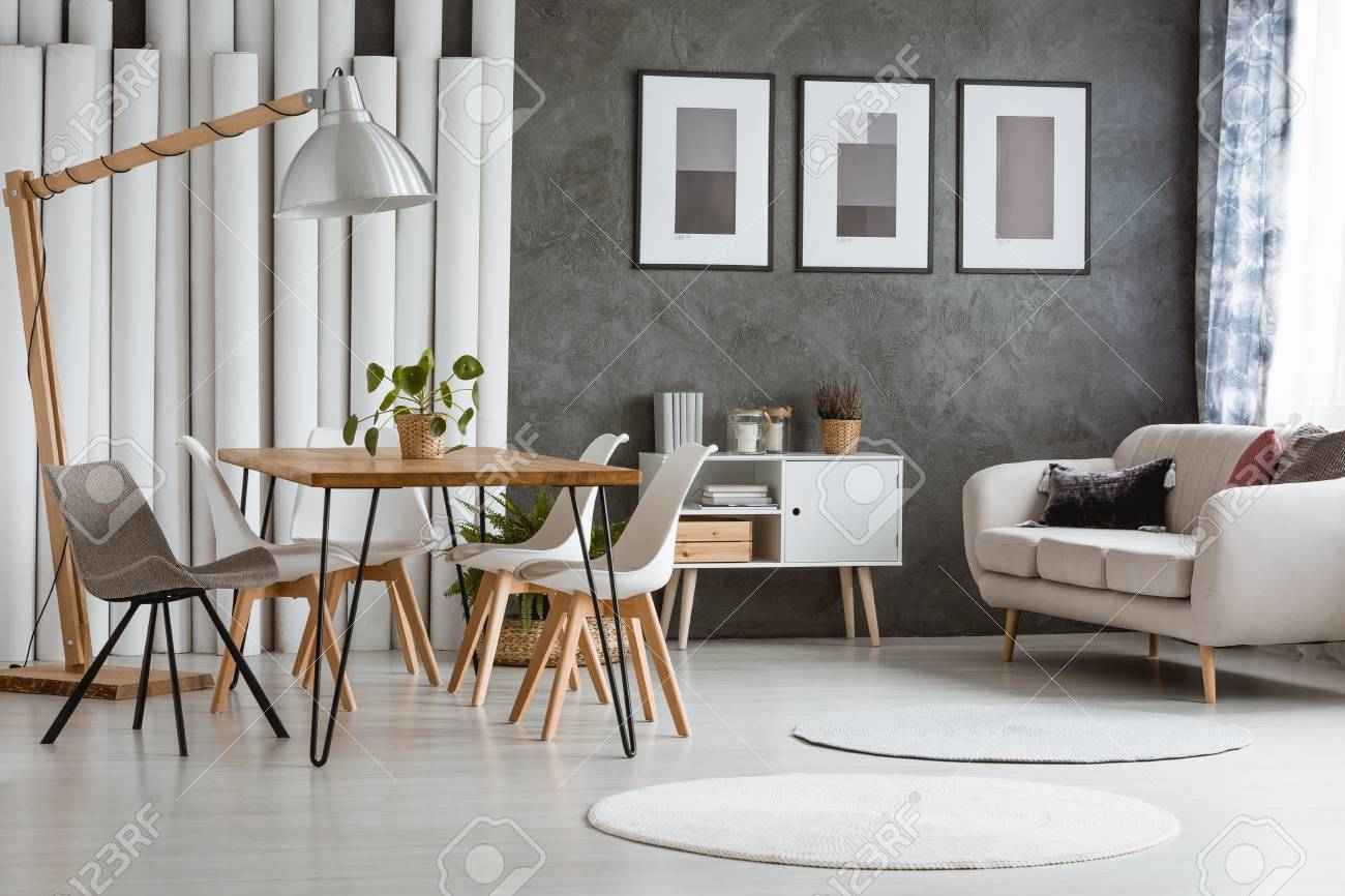 White round carpets in bright living room with cupboard between..
