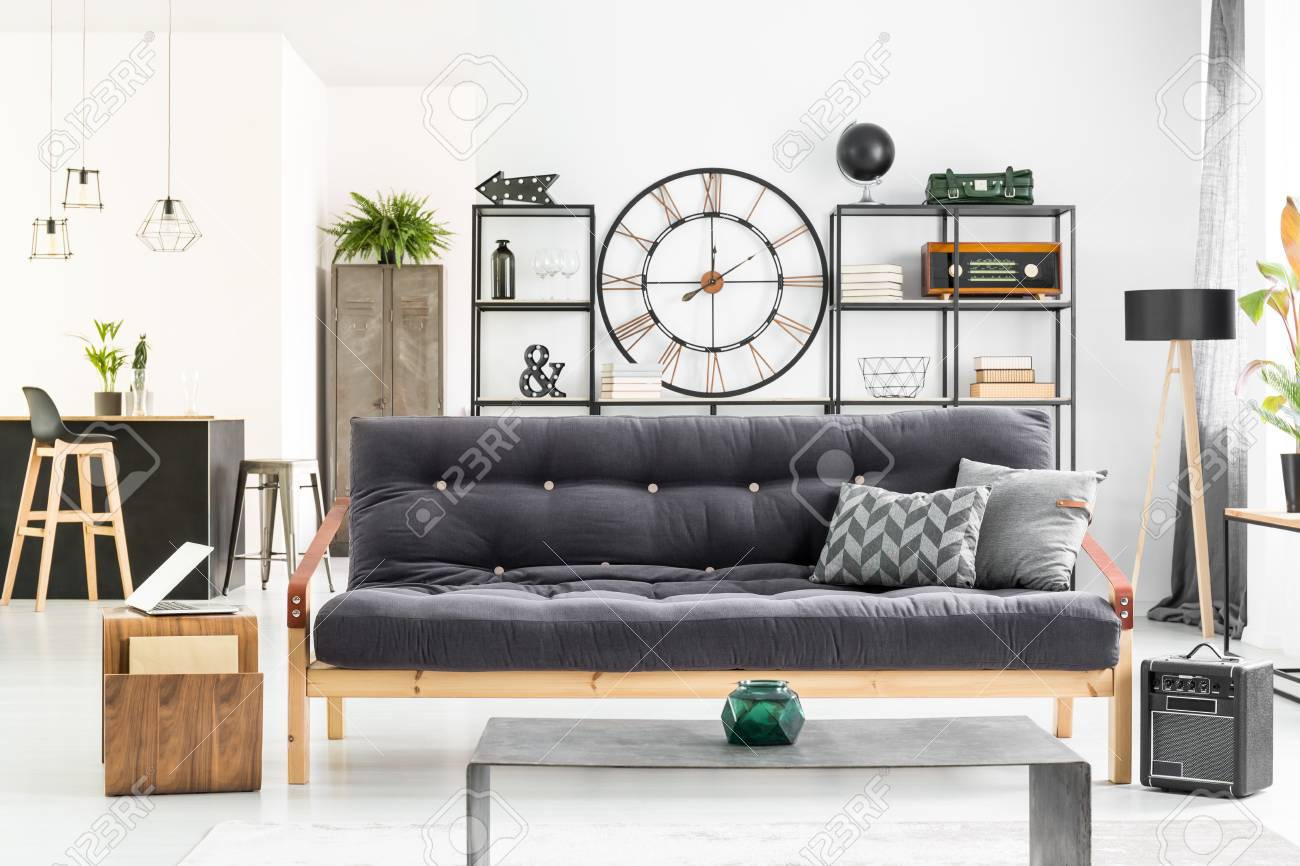 big clock hanging on the wall in living room interior with black rh 123rf com big wall clocks for living room india