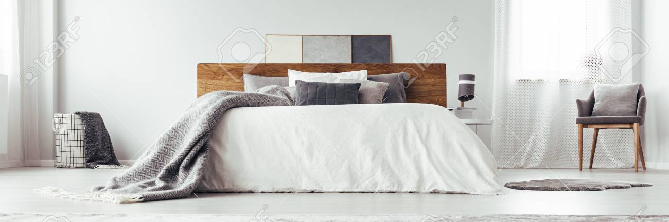 Low Angle Of Grey Patterned Blanket On White King Size Bed In ...