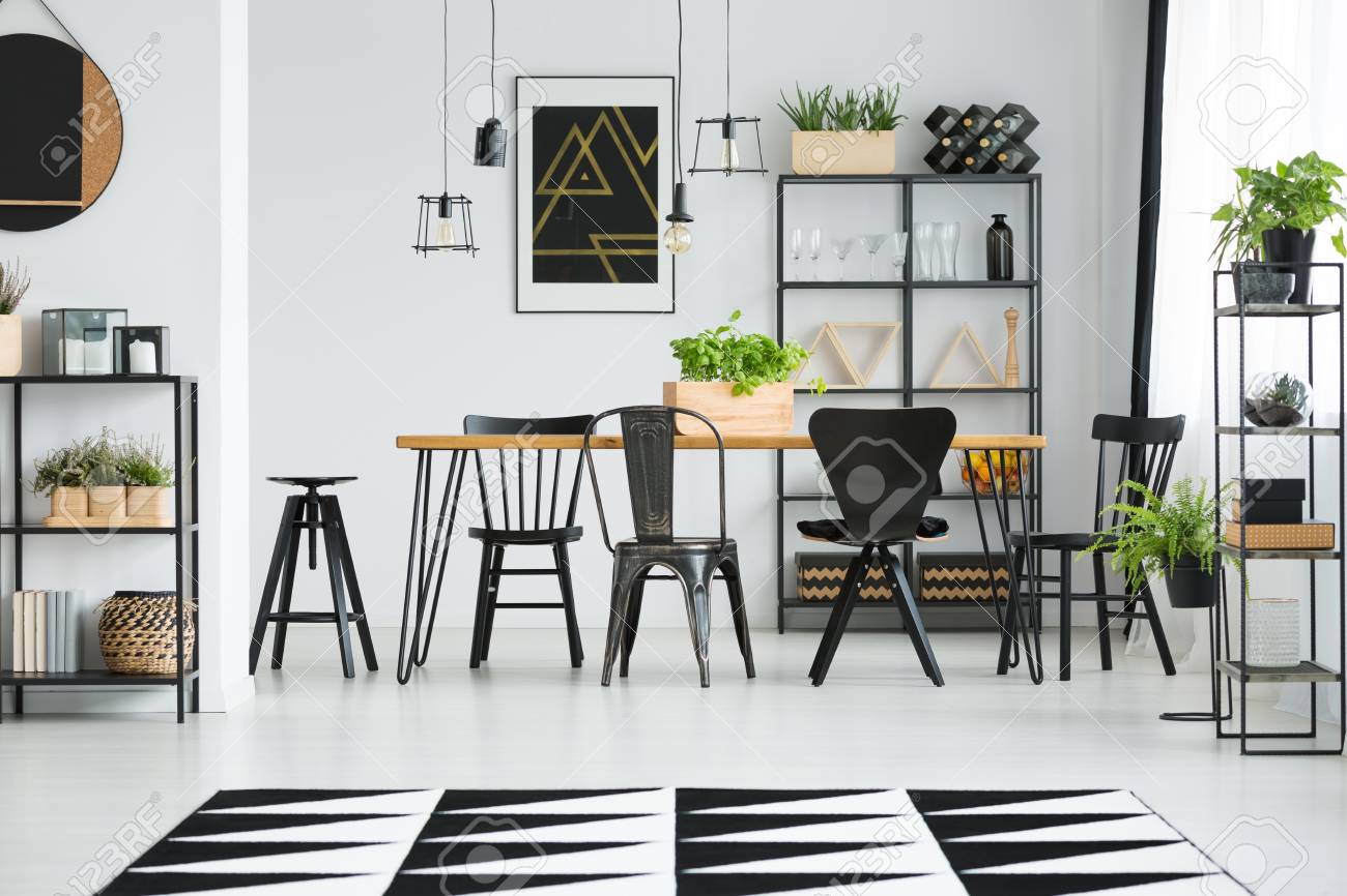 Black Chairs At Table In Scandinavian Style Dining Room With Stock Photo Picture And Royalty Free Image Image 97990937