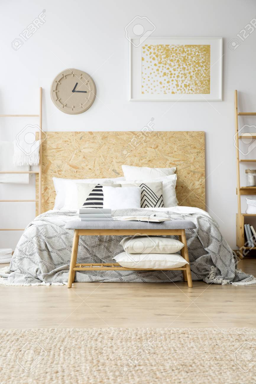 Pillows On Wooden Bench In Boho Bedroom With Gold Painting And Stock Photo Picture And Royalty Free Image Image 97990939
