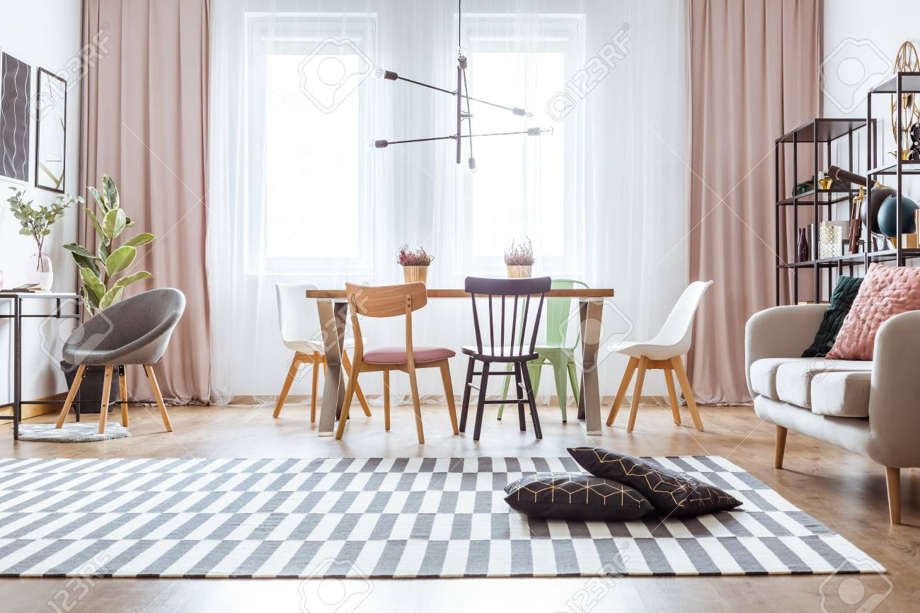 Black Pillows On Patterned Carpet And Pink Drapes In Cozy Living