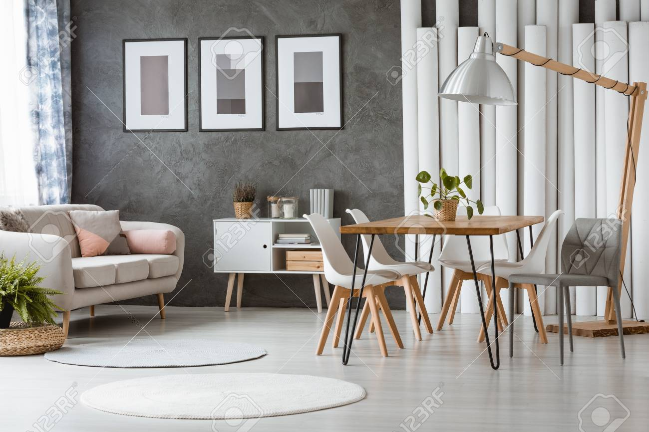 Bright dining room with white plastic chairs and relax space..