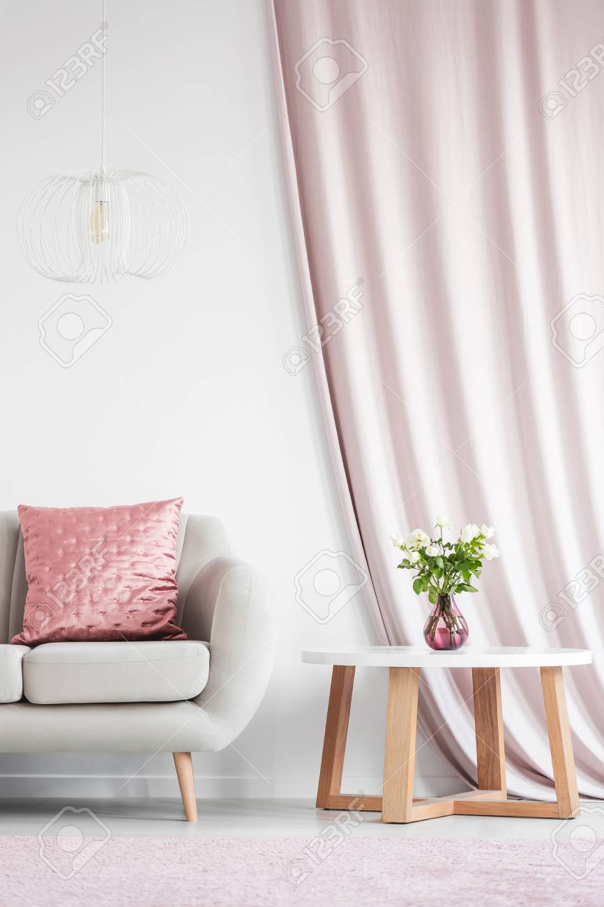 White Lamp Above Beige Sofa With Pink Cushion In White Living ...