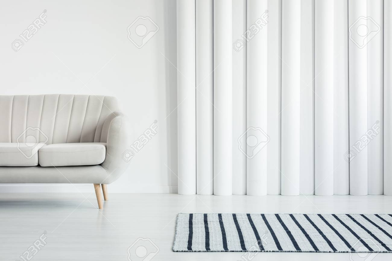 Beige Sofa In White Living Room Interior With Striped Rug And ...