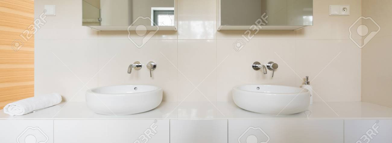 Big Modern White Bathroom With Two Bowl Sinks And Mirrors Above