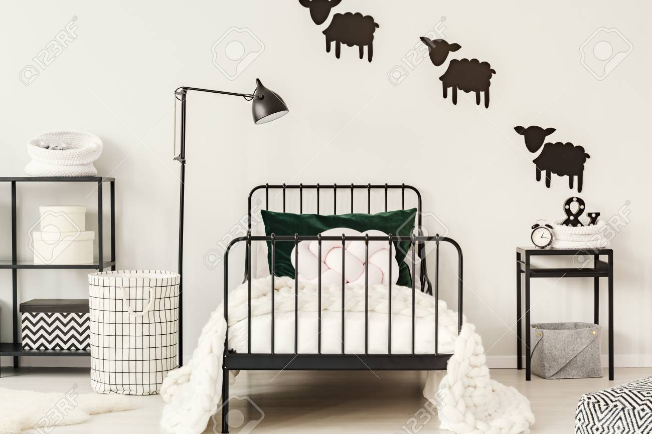 Black Lamp Next To Bed With White Bedding In Simple Child Bedroom Interior Clock On
