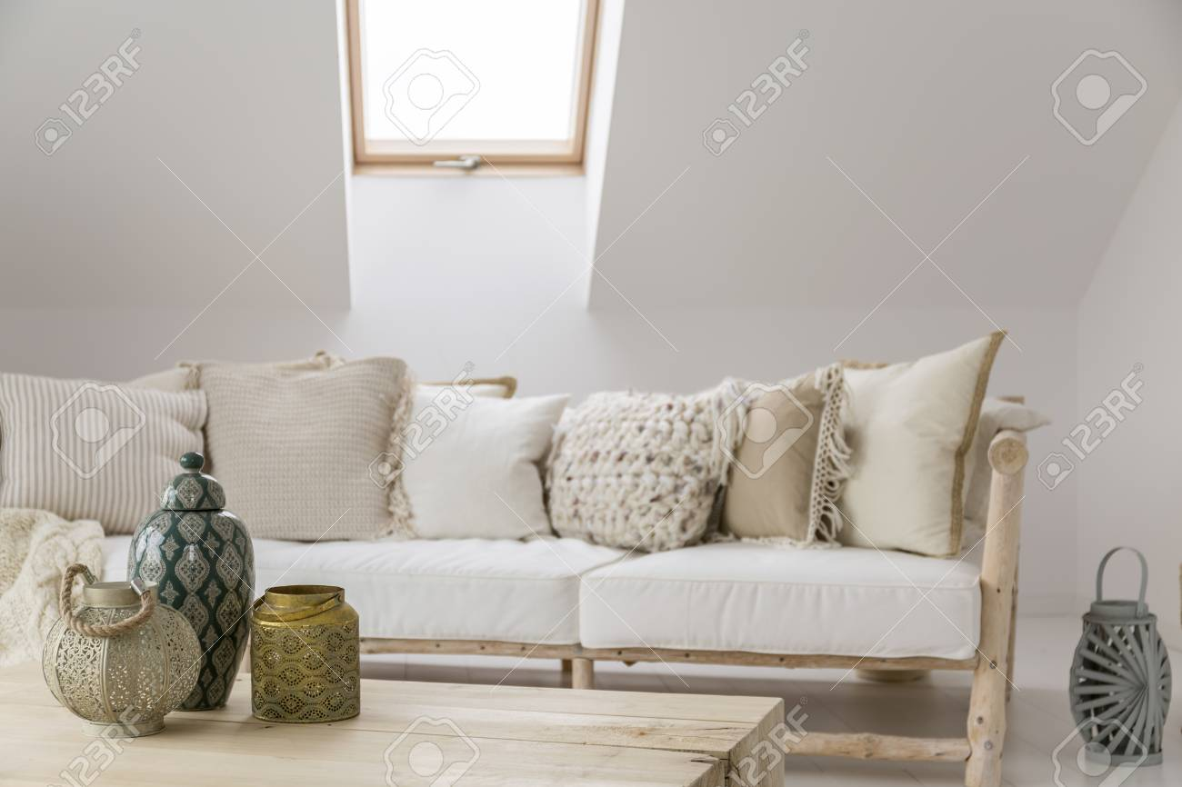 Decorative Accessories On Wooden Table In Front Of Beige Sofa ...