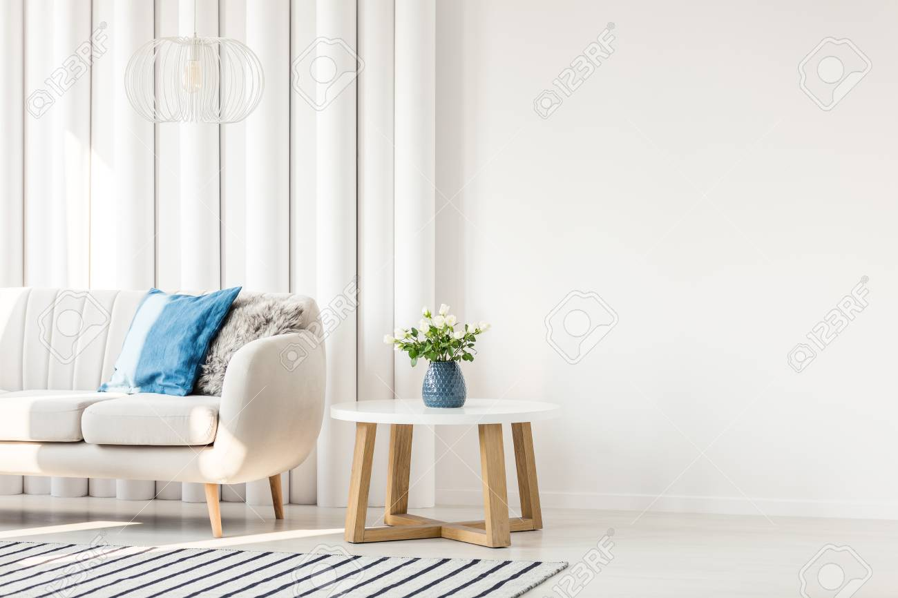Sensational White Wooden Table Next To Sofa With Blue Cushion In Empty Wall Uwap Interior Chair Design Uwaporg