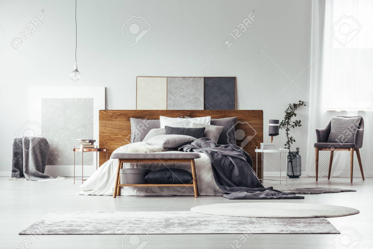 Gray And White Rugs In Monochromatic Bedroom Interior With Wooden Stock Photo Picture And Royalty Free Image Image 93955812