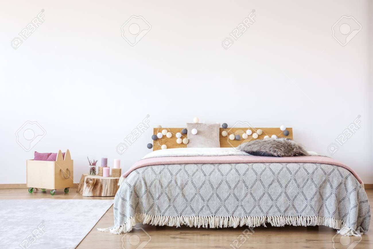 Pink Blanket On King Size Bed In Girl S Bedroom With Wooden Crate Stock Photo Picture And Royalty Free Image Image 93955813