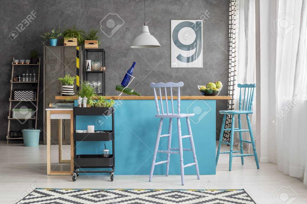 Blue And Purple Barstools At Kitchen Island With Wooden Countertop ...