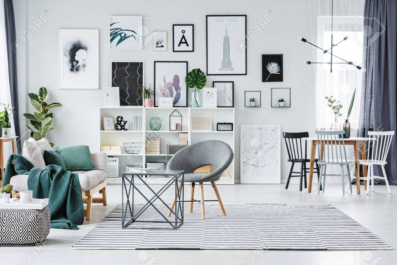 Grey Chair On Patterned Carpet Near Sofa In Spacious Living Room ...