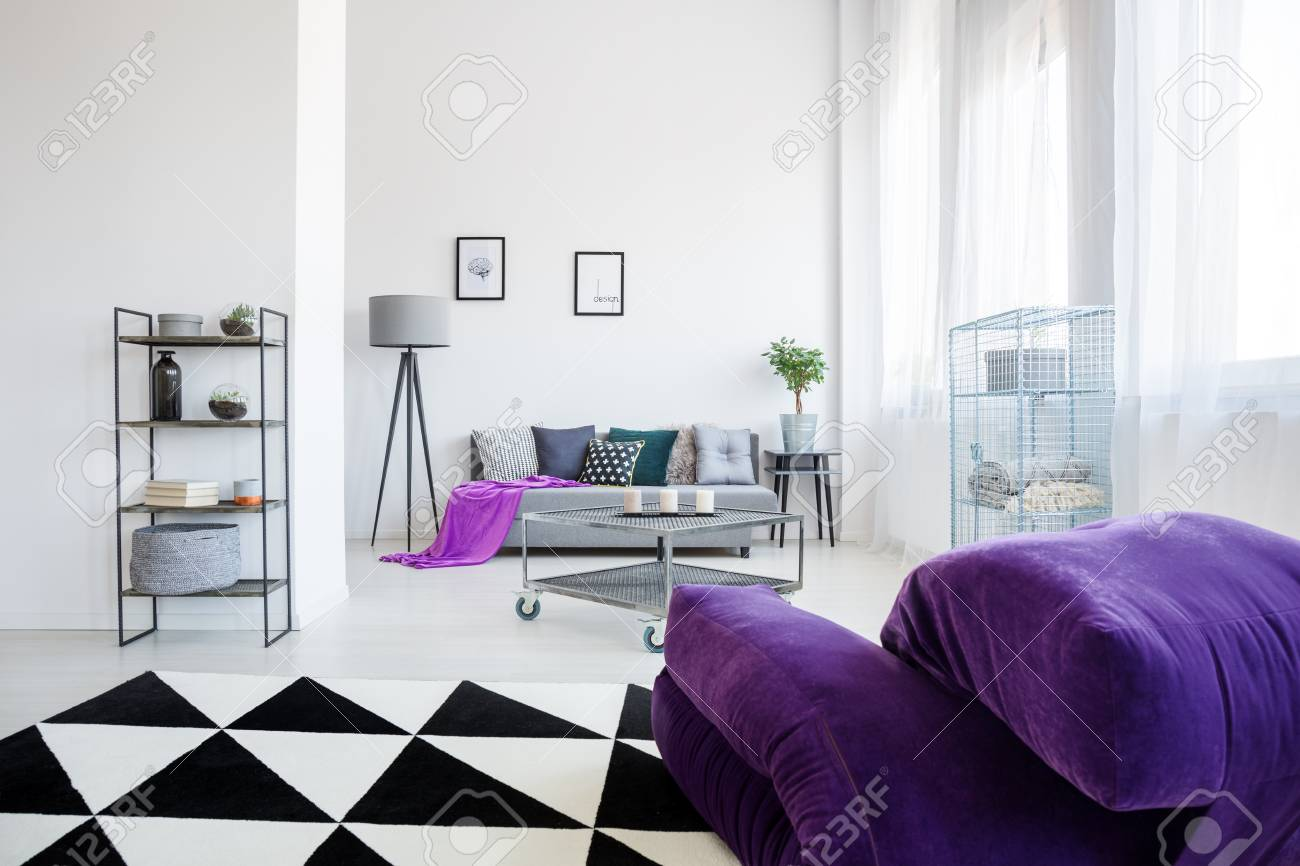 Soft Purple Pouf On A Carpet With Geometric Pattern In Modern ...