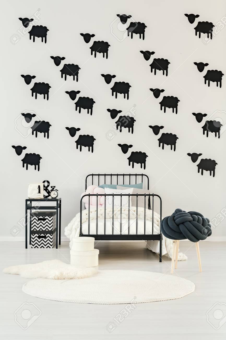 White Round Rug And Knit Blanket On Child S Bed In Bedroom Interior
