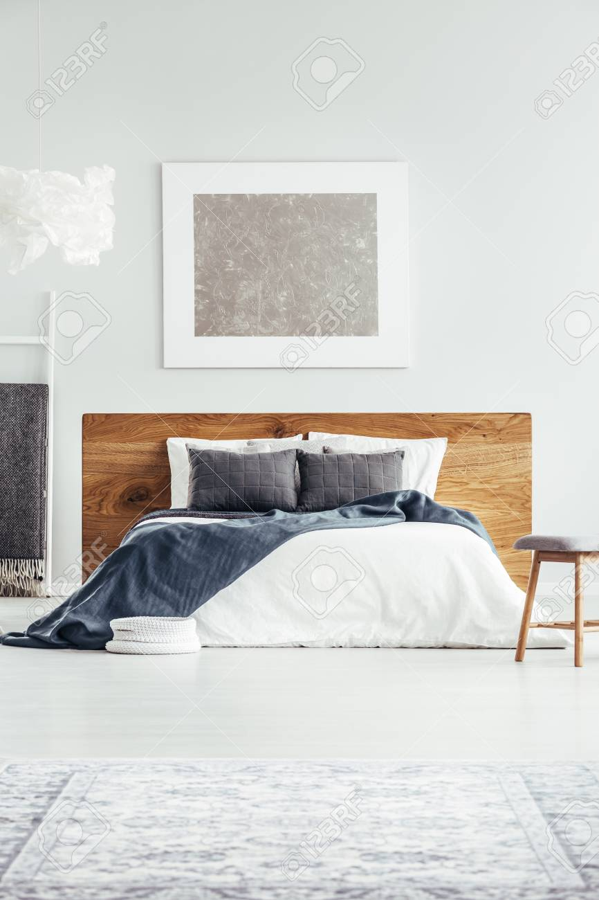 White Bedding Gray Pillows And Navy Blue Blanket On Wooden Bed Stock Photo Picture And Royalty Free Image Image 97678286