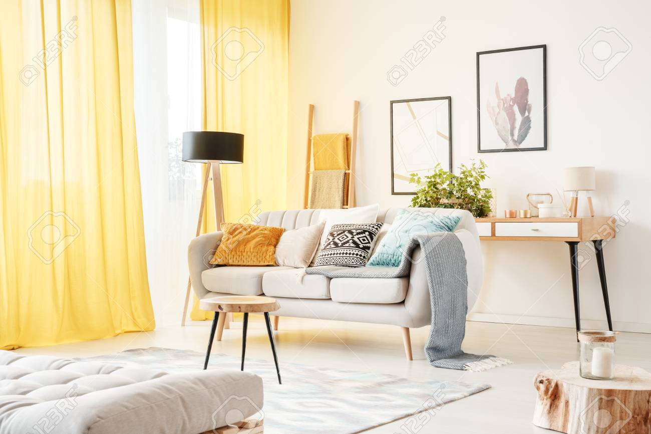 Small Ladder Standing Behind A Comfy Couch In A Bright Boho Apartment Stock Photo Picture And Royalty Free Image Image 94127461