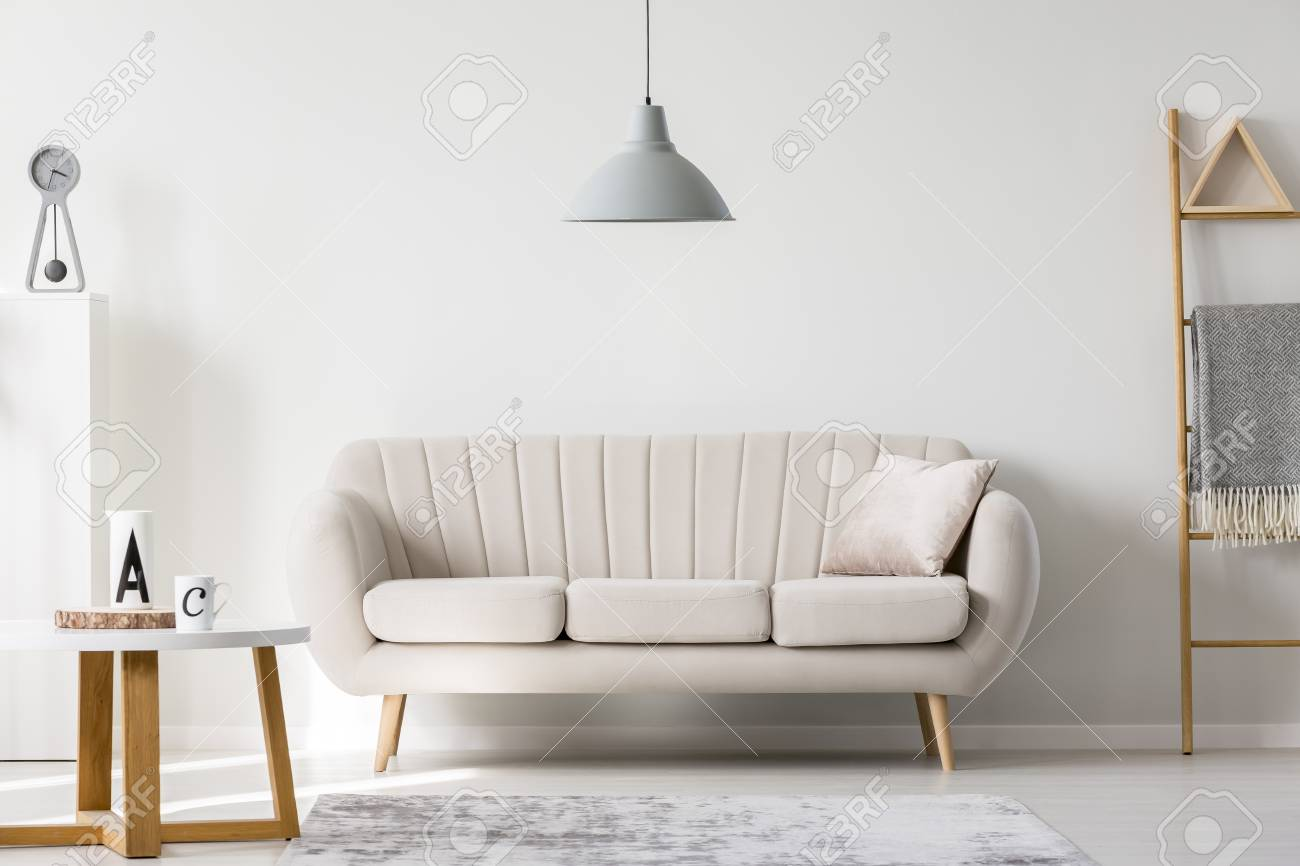 Gray Lamp Above Beige Couch In Sophisticated Living Room Interior ...