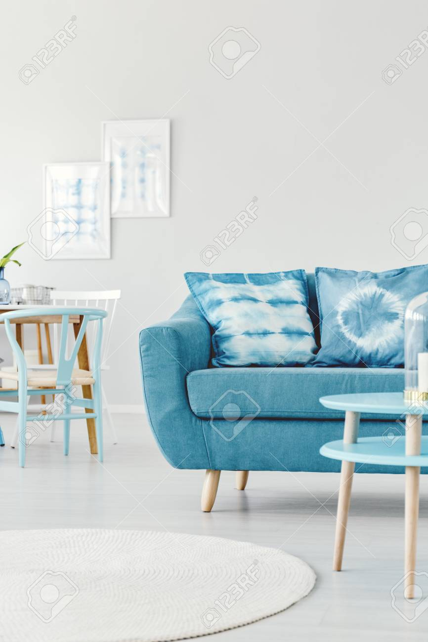 Patterned Pillows On Turquoise Settee In Bright Living Room Interior ...