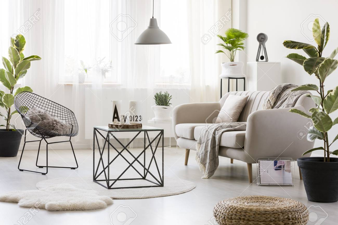 Black Table On White Round Rug In Bright Living Room Interior