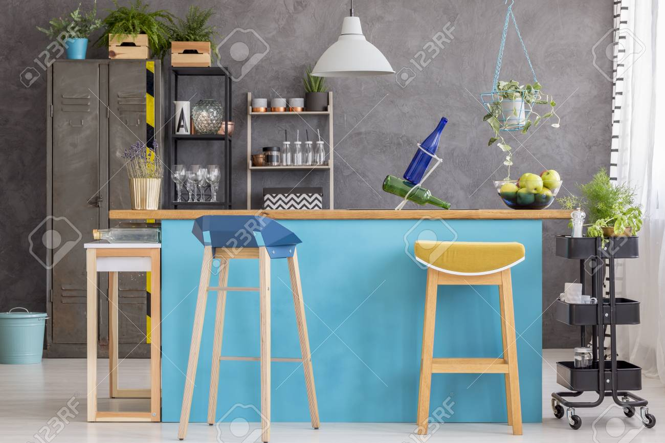 Two Modern Barstools Standing By A Light Blue, Stylish Kitchen ...