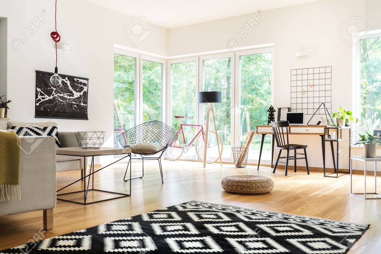 Black And White Carpet And Pouf In Multifunctional Living Room ...