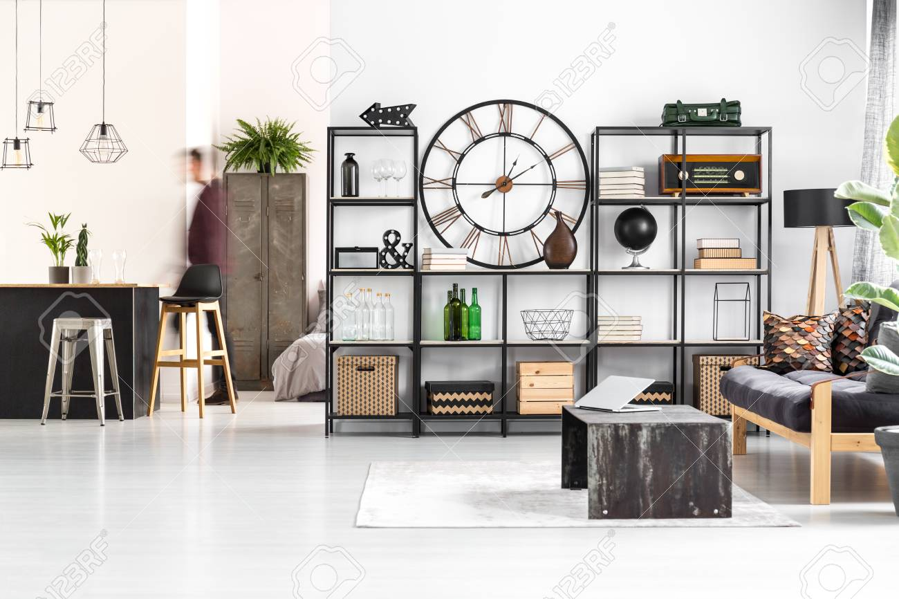 Round Clock And Radio On The Shelf In Retro Living Room Interior ...