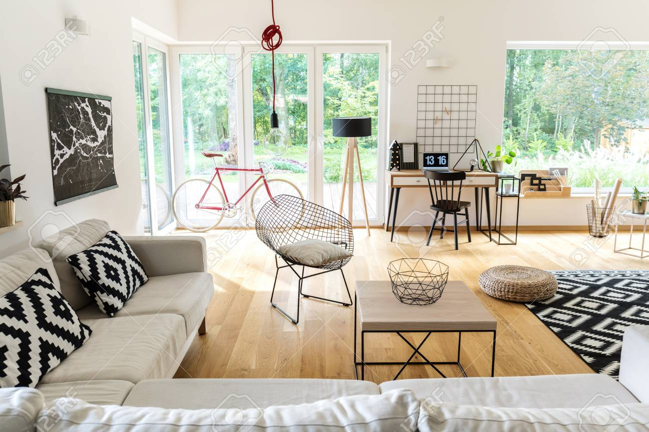 Corner Couch With Pillows And Table In Spacious Scandi Living Room With  Workspace And Bike Stock