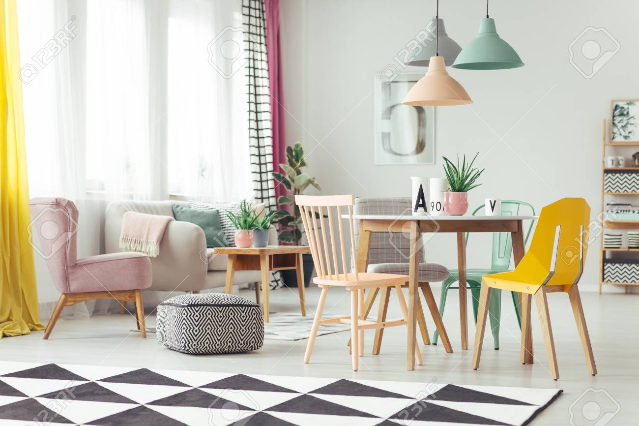 Geometric Carpet In Colorful Living Room Interior With Pink Armchair ...