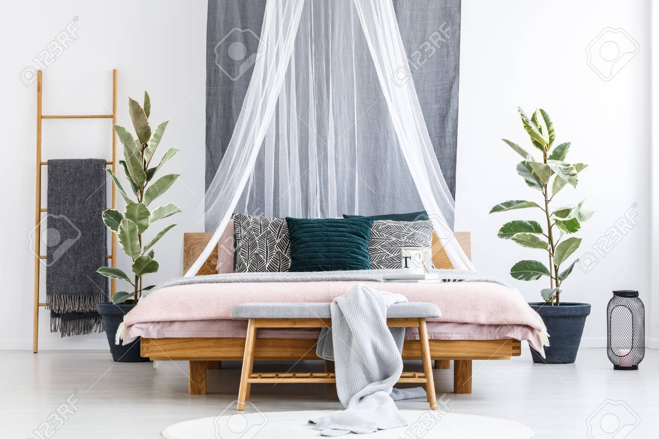 Blanket On Wooden Bench In Front Of Bed With White Drapes In Stock Photo Picture And Royalty Free Image Image 97010052