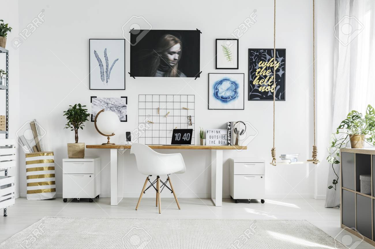 White Chair At Wooden Desk In Bright Home Office Interior With Stock Photo Picture And Royalty Free Image Image 96074502