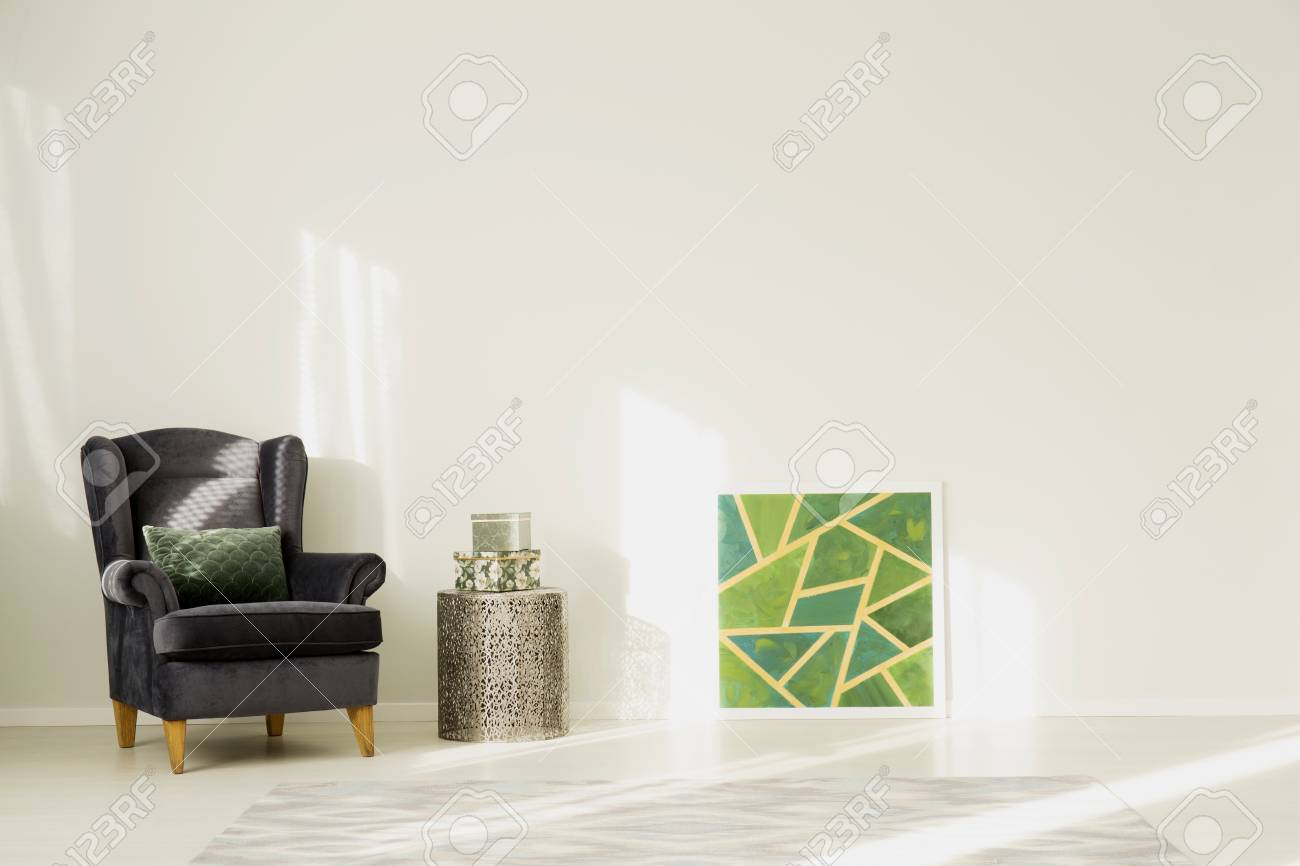 Green Painting Against White Wall With Copy Space In Living Room ...