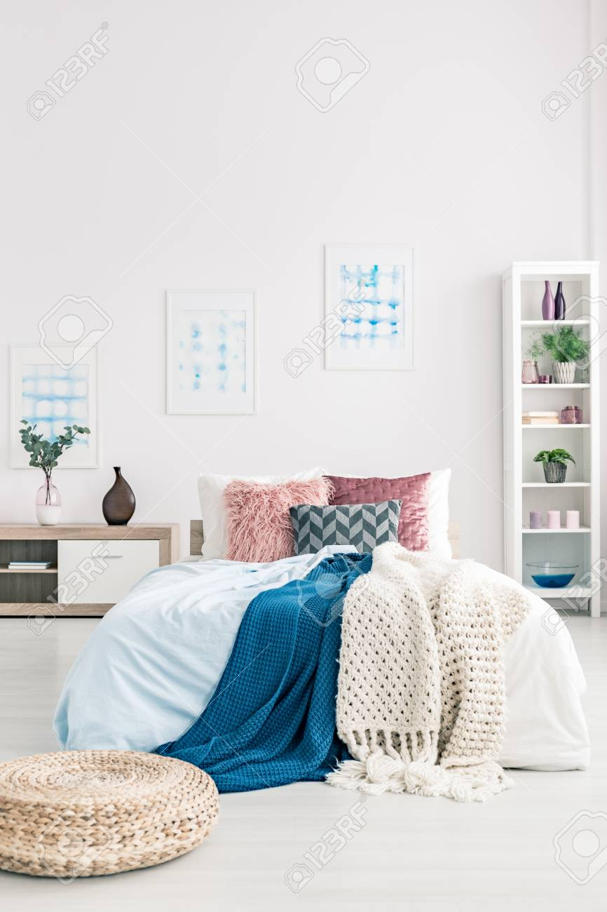 Pouf Near Bed With Navy Blue Blanket Against White Wall With Stock Photo Picture And Royalty Free Image Image 96593158