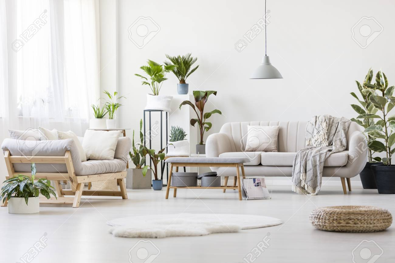Pouf And White Fur In Spacious Floral Living Room Interior With ...