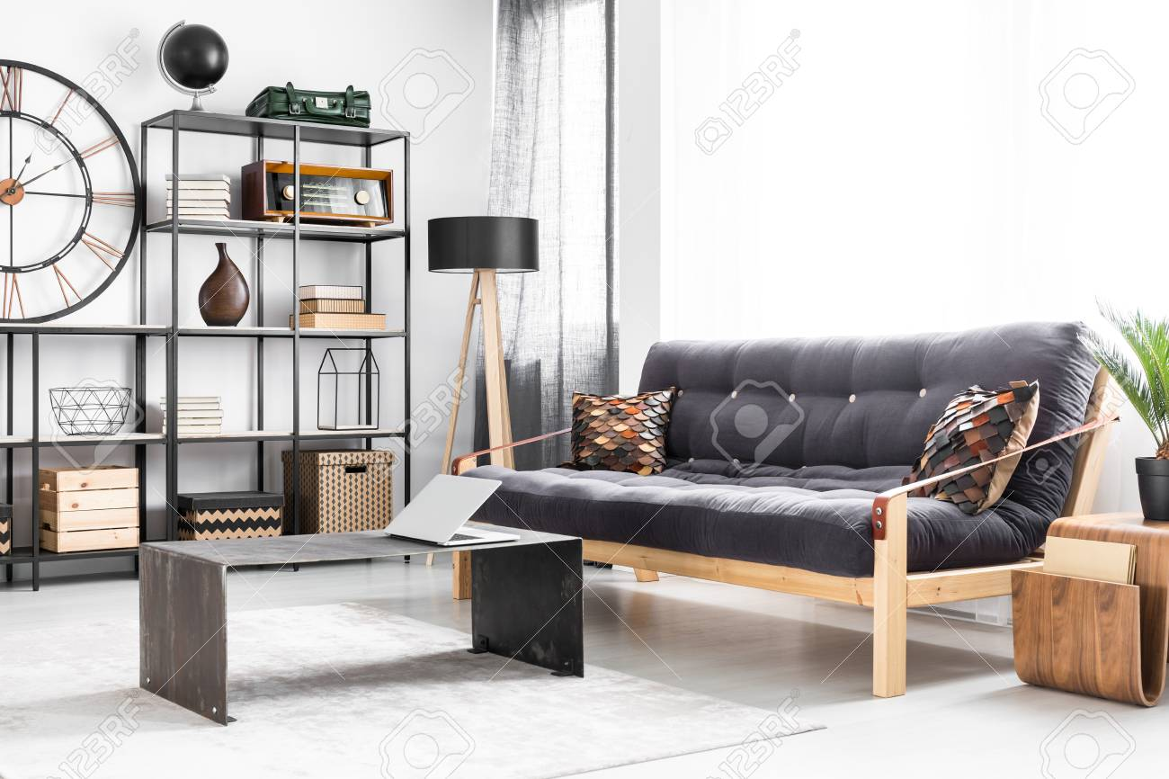 Manly apartment interior for a freelancer with laptop on modern industrial table next to a