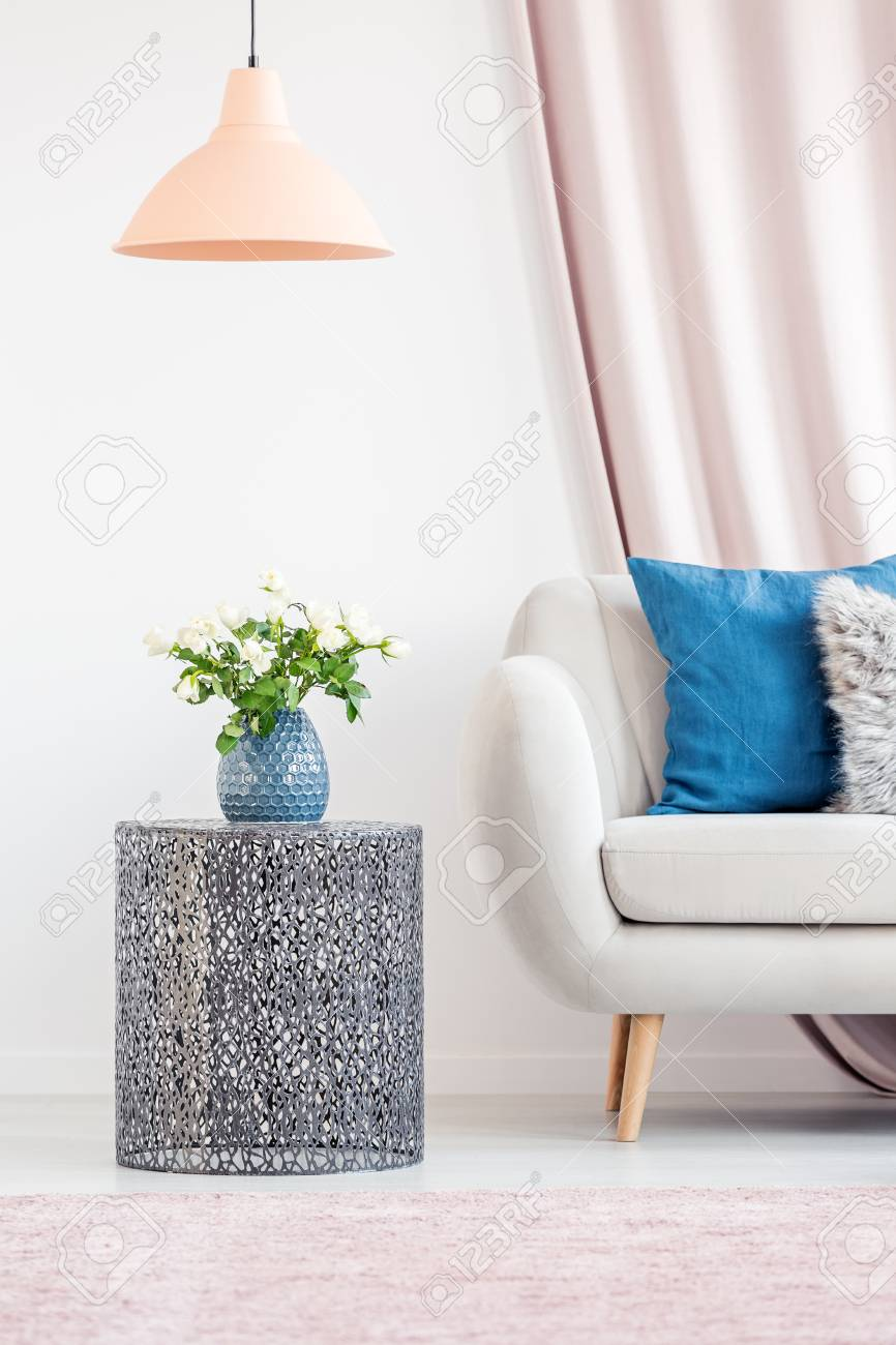 Living Room Interior With A Metal Side Table, A Blue Vase And ...