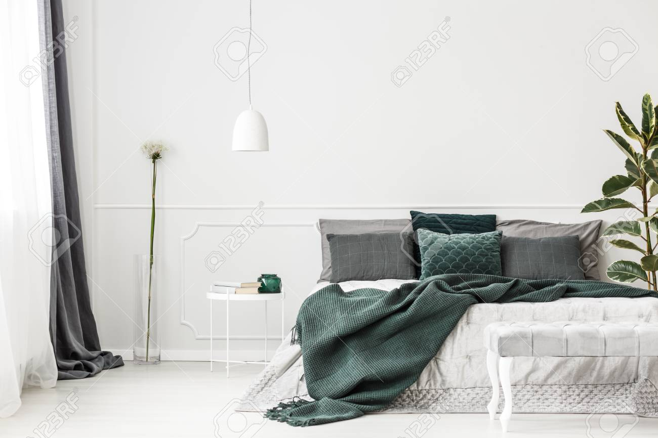 Emerald Green Bedding On Bed With Pillows Against White Wall Stock Photo Picture And Royalty Free Image Image 97183356