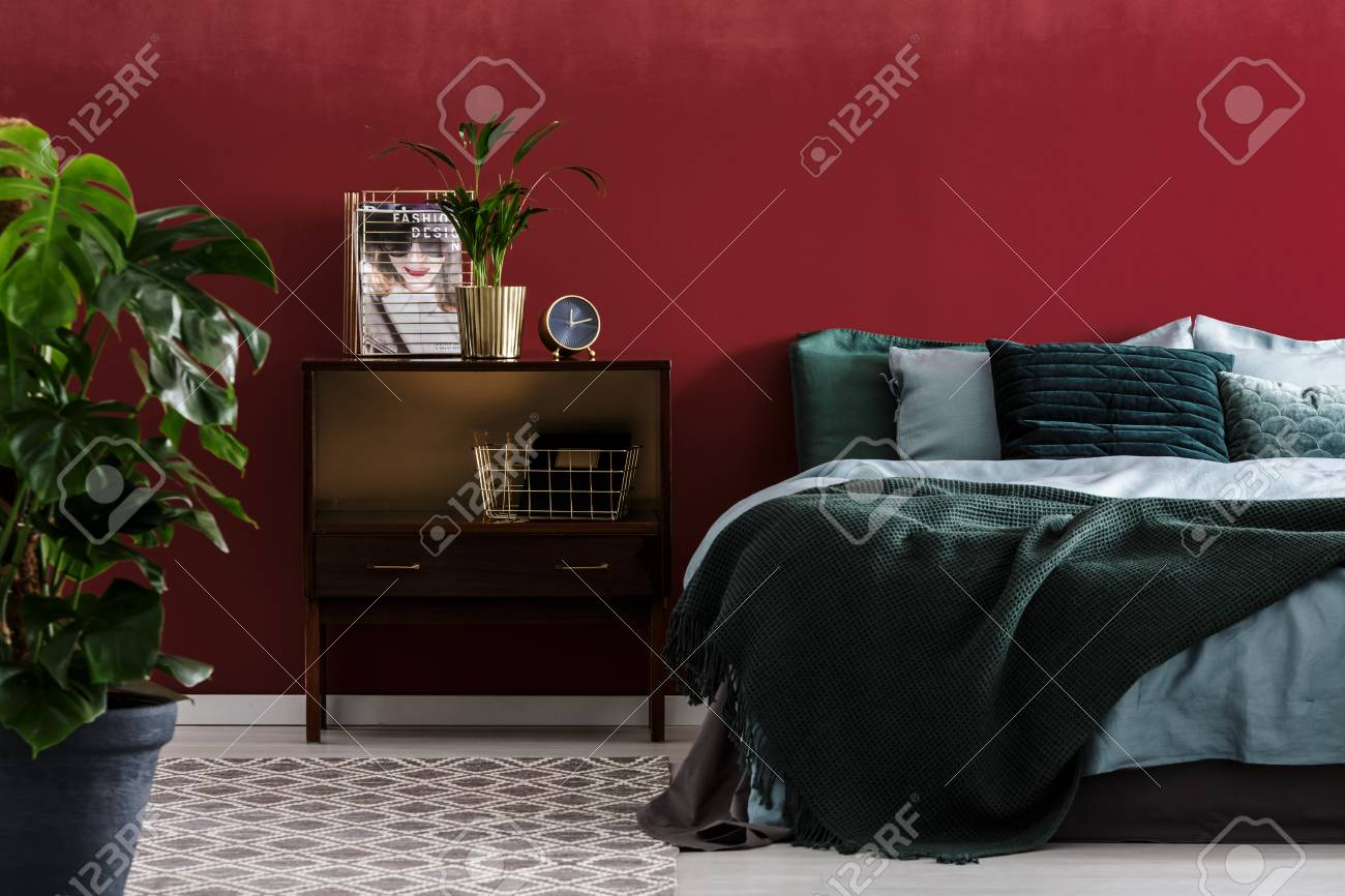 Plant In Gold Pot On Nightstand Next To Bed With Emerald Green Stock Photo Picture And Royalty Free Image Image 97578295