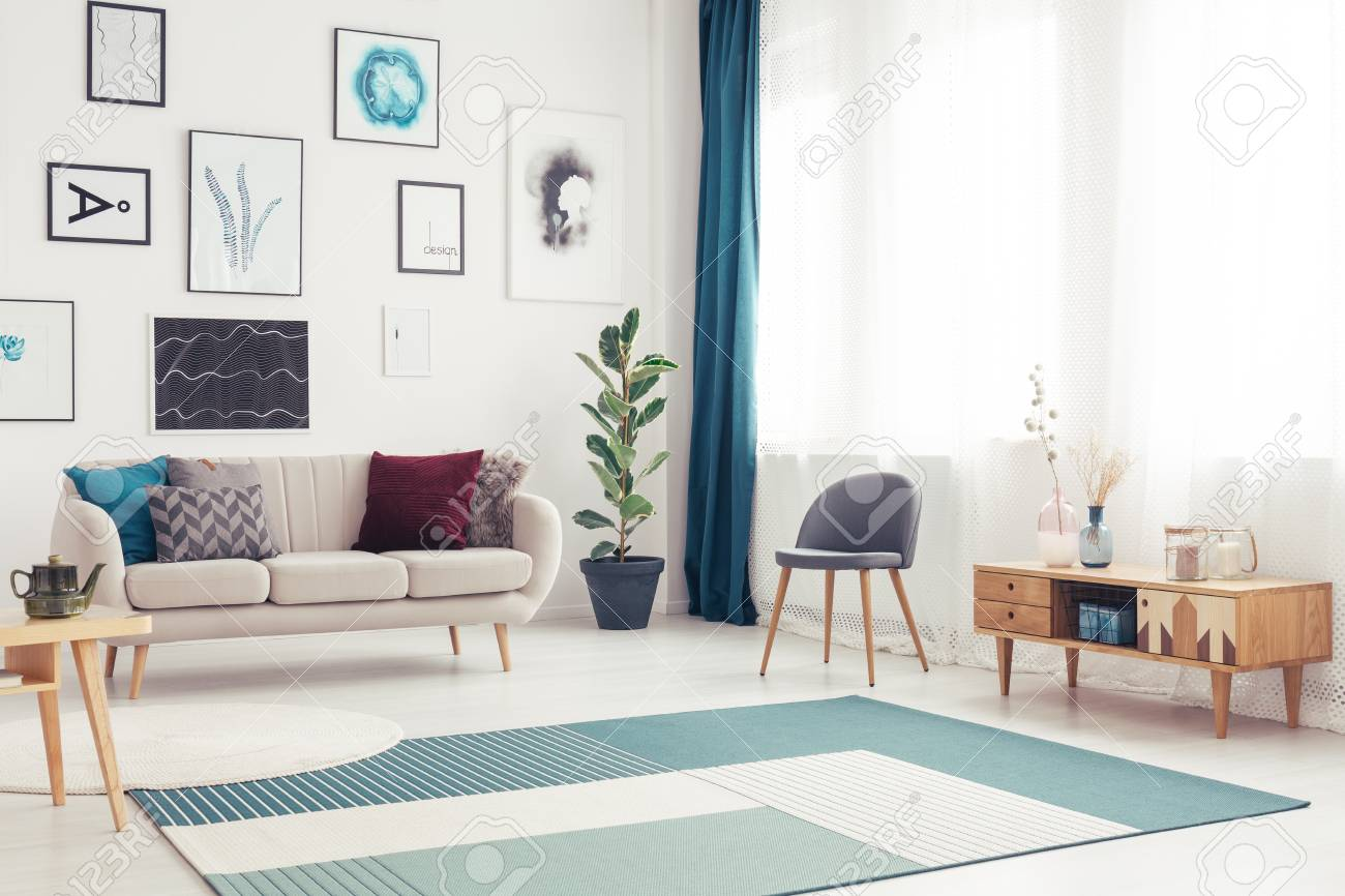 Blue Carpet And Wooden Cupboard In Living Room Interior With Stock Photo Picture And Royalty Free Image Image 97267981