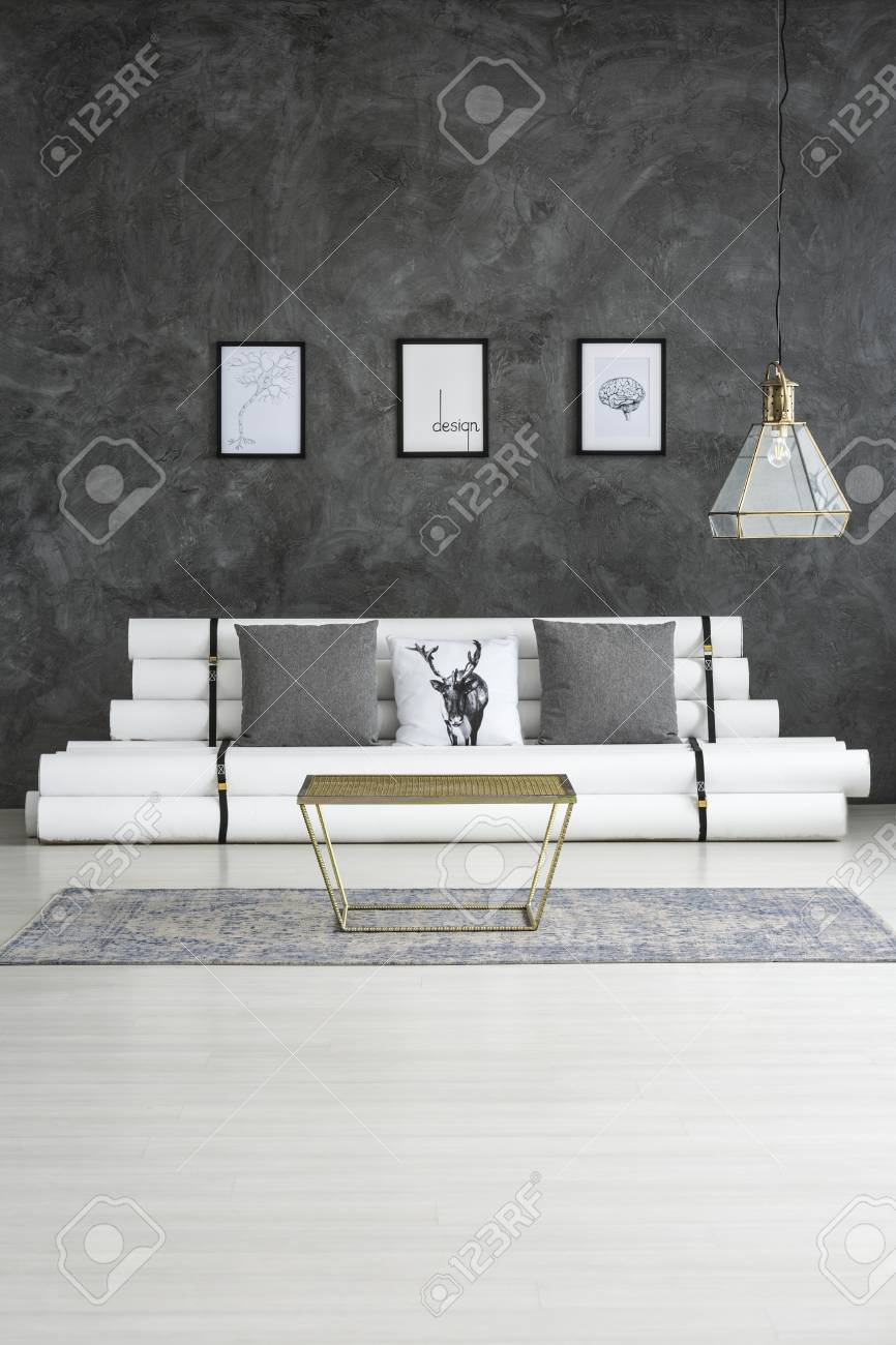 Gold Table On Grey Carpet Near Sofa In Cozy Living Room Interior Stock Photo Picture And Royalty Free Image Image 97267994