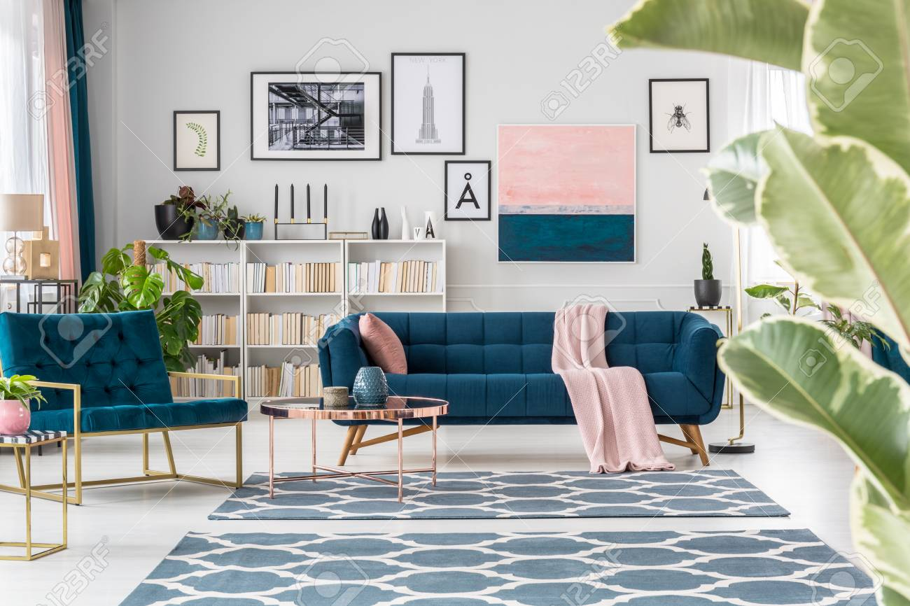 Copper Table Near Navy Blue Sofa And Armchair In Sophisticated Stock Photo Picture And Royalty Free Image Image 97321019