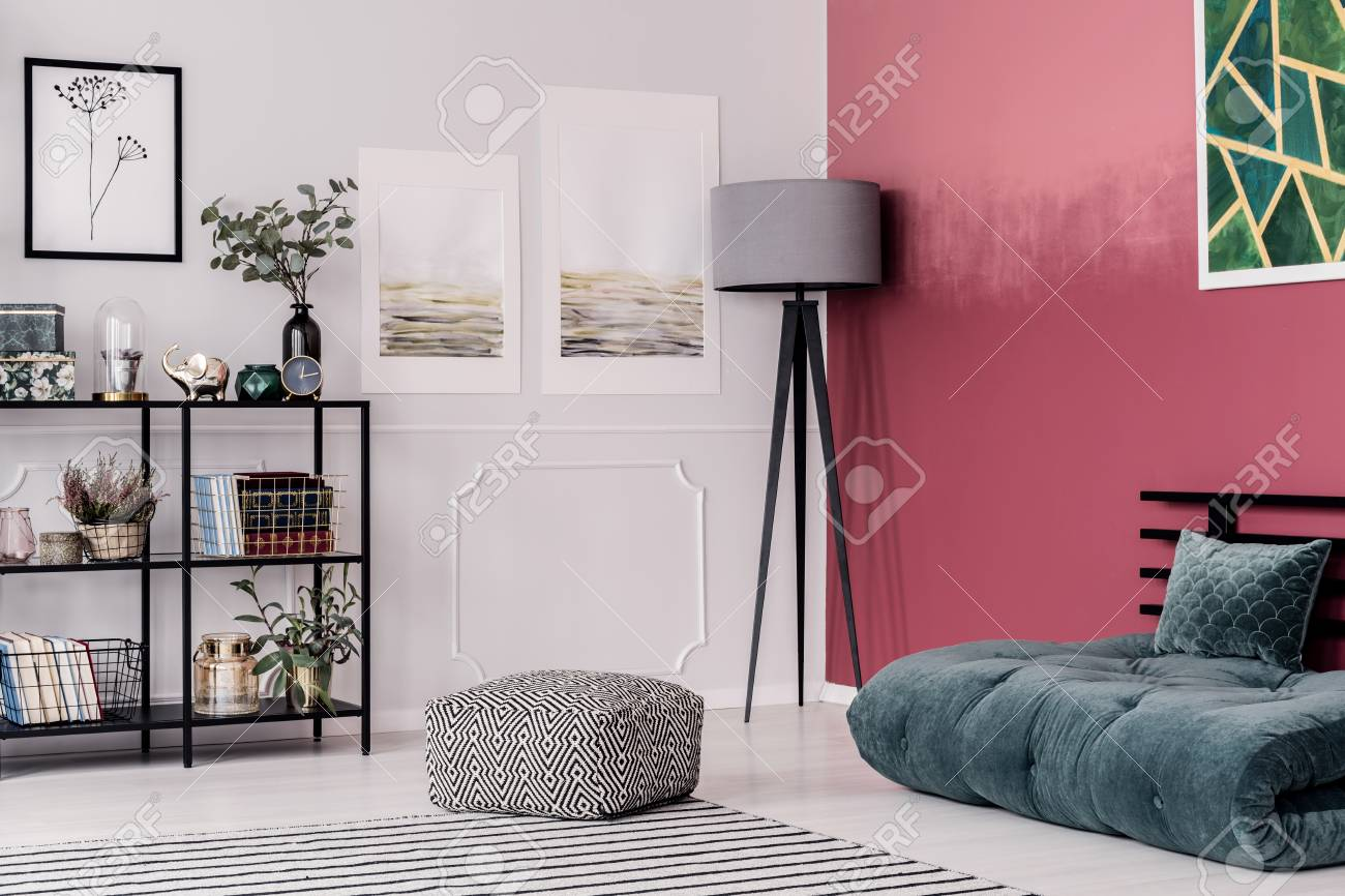 Modern lamp standing in the corner of bright living room interior..