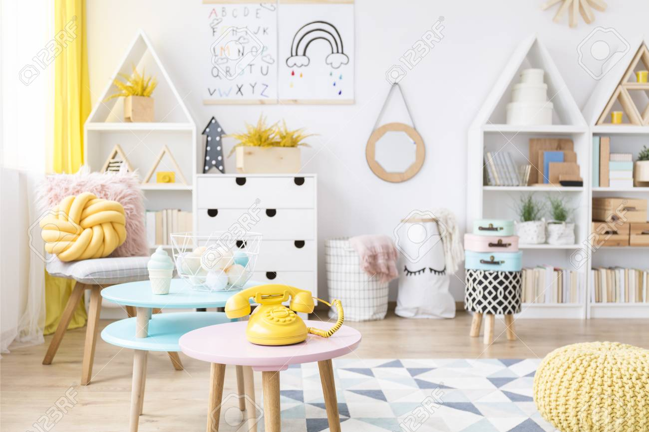 Pink Round Table.Yellow Phone On Pink Round Table In Scandi Child S Playroom