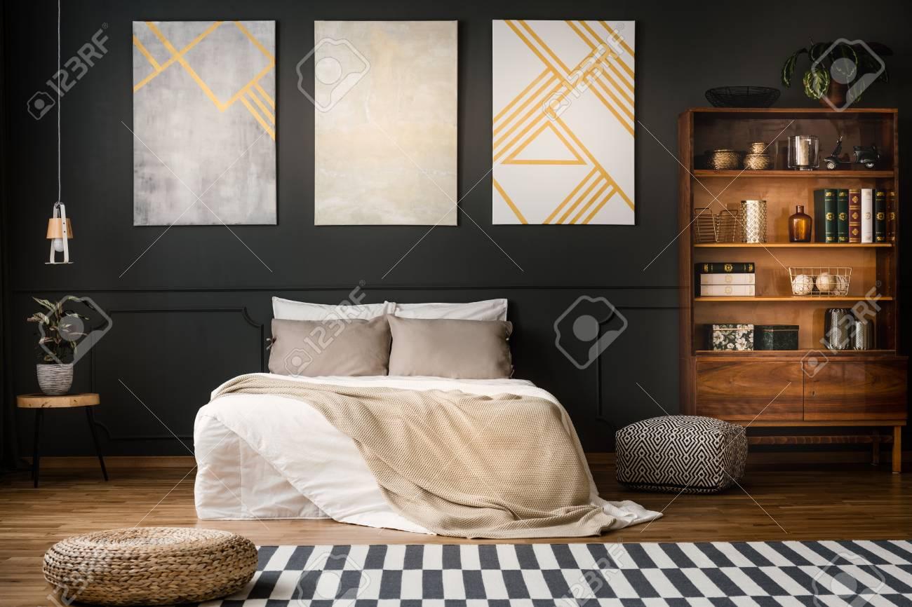 Elegant Wooden Antique Bookcase In A Dark Modern Bedroom Interior