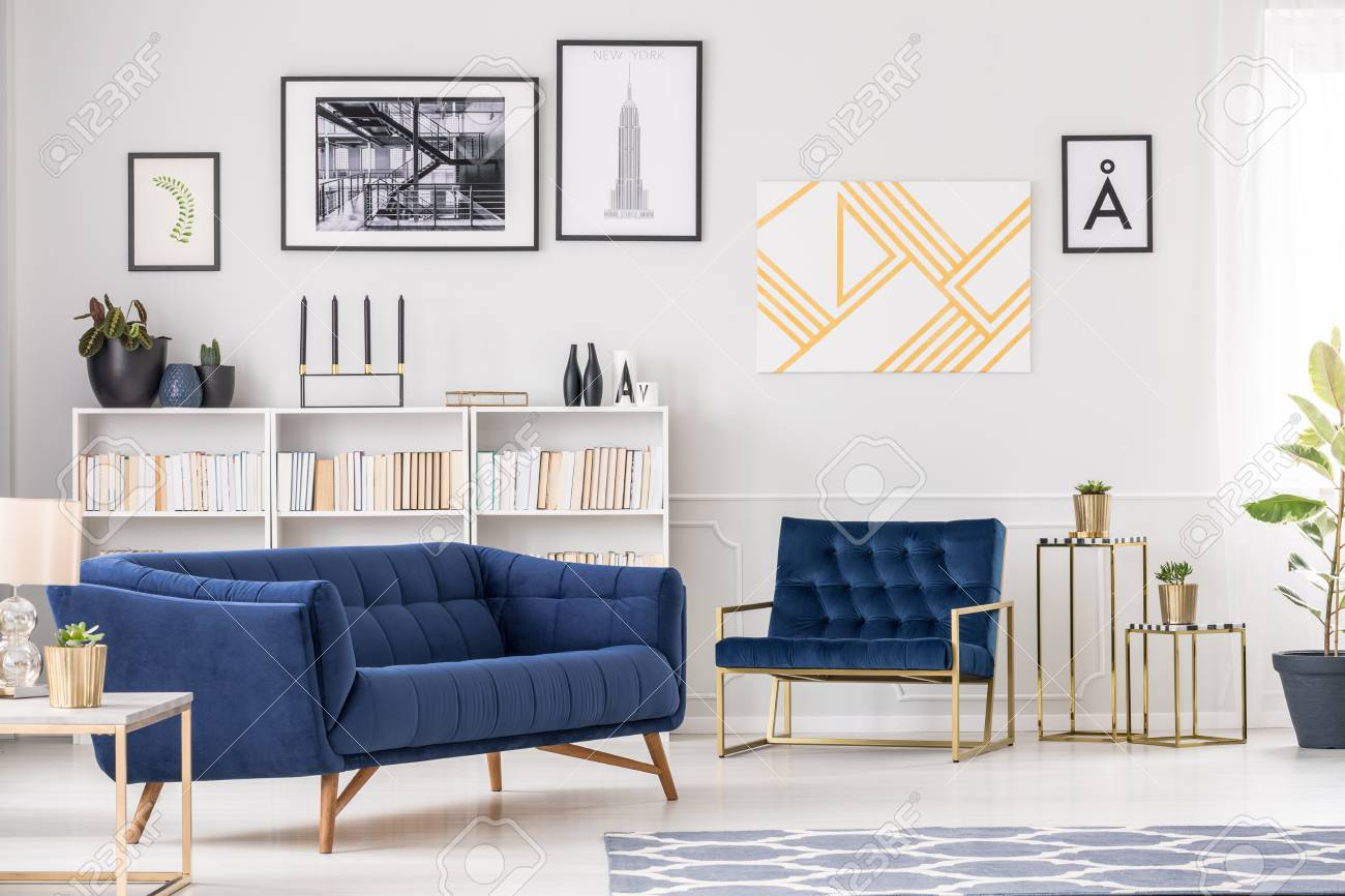 Art Collection White Bookshelf Blue Sofa And Armchair In Modern Stock Photo Picture And Royalty Free Image Image 97947706